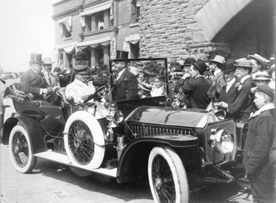 Prime Minister of Canada Sir Wilfrid Laurier in a Napier car in front of the CPR Station August 16, 1910. Laurier opened the first Vancouver Exhibition at Hastings Park in 1910. Also in photo Ewing Buchan, L.D. Taylor, J.H. (Harry) Senkler and others. City of Vancouver Archives Port P878