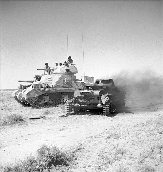 A British M3 Grant tank next to a knocked out a German Panzerkampfwagen I light tank on 6 June 1942 in North Africa. #worldwar2 #tanks