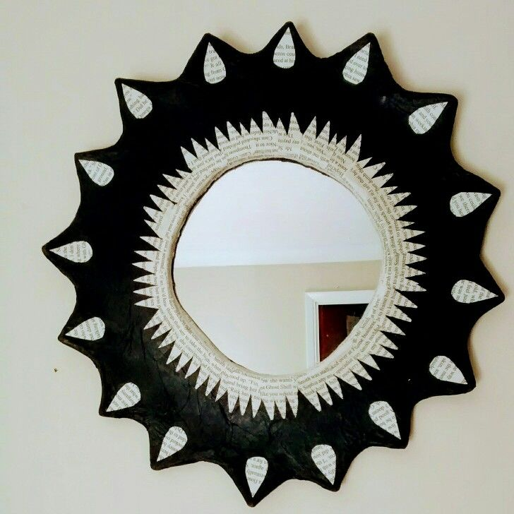 black daisy mirror with repurposed book pages.