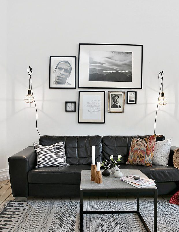 Black Leather Couch, Artwork And Hanging Lights / Lanterns