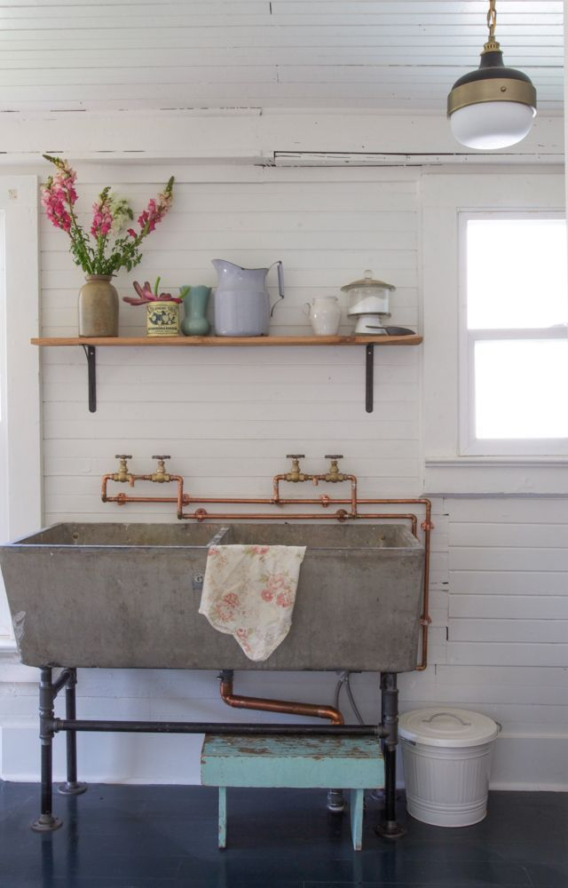 Exposed copper pipe and a recycled sink.. love this against the clean white walls... very cute.