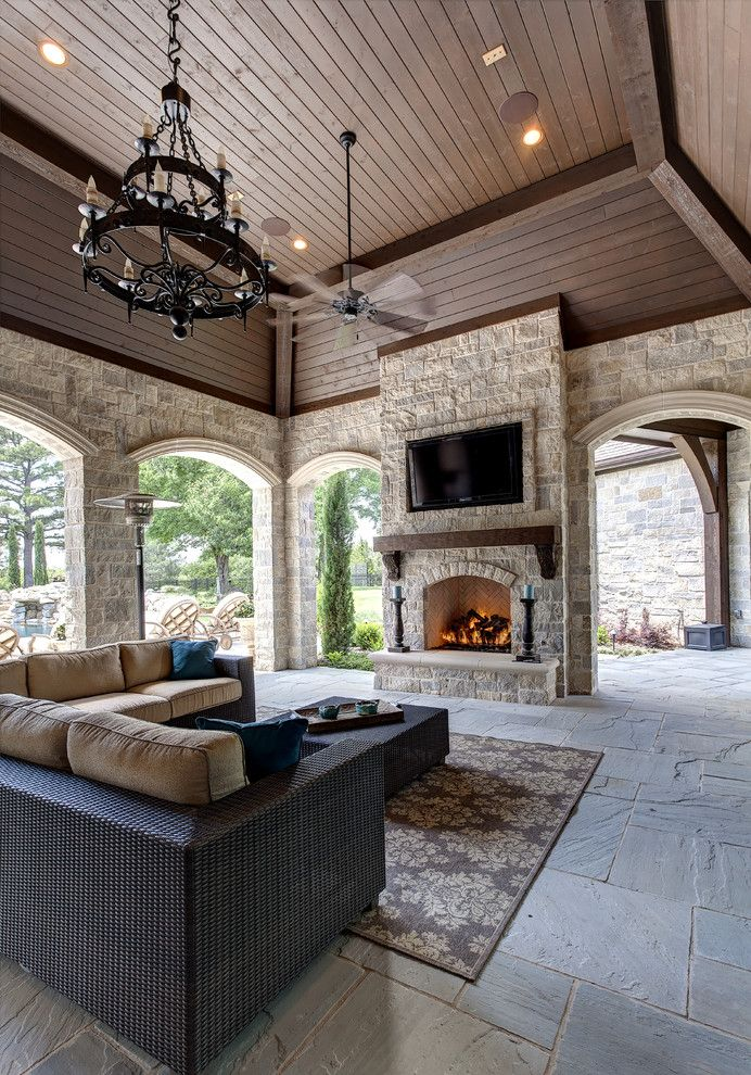 gorgeous covered patio with natural stone fireplace and