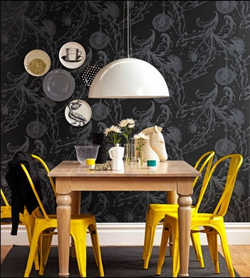 We love how the yellow chairs create a stunning contrast in this monochrome dinning room!