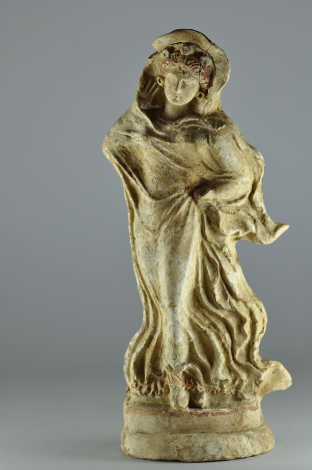 Greek Tanagra figurine, 3rd century B.C. Greek Tanagra terracotta statuette of draped female with red hairs and earrings, 25 cm high. Private collection