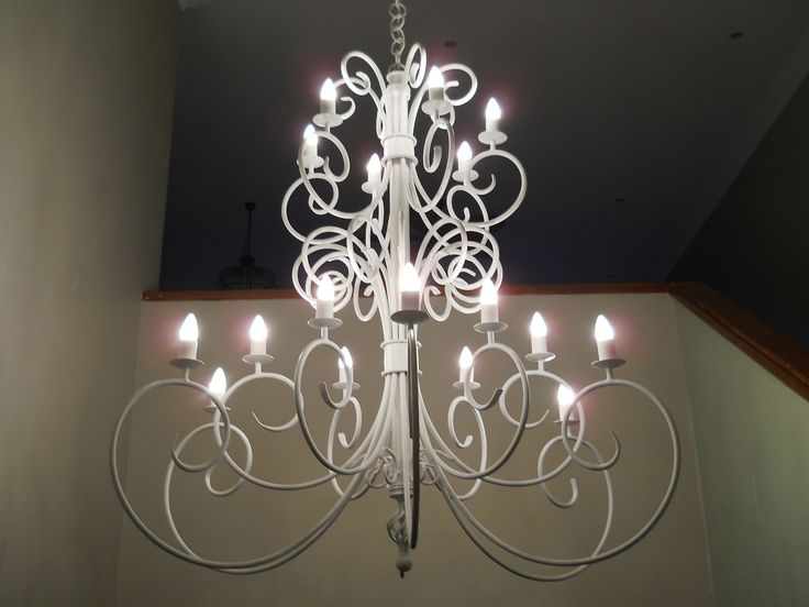 Ice white chandelier in double volume area. www.cherylincreations.co.za