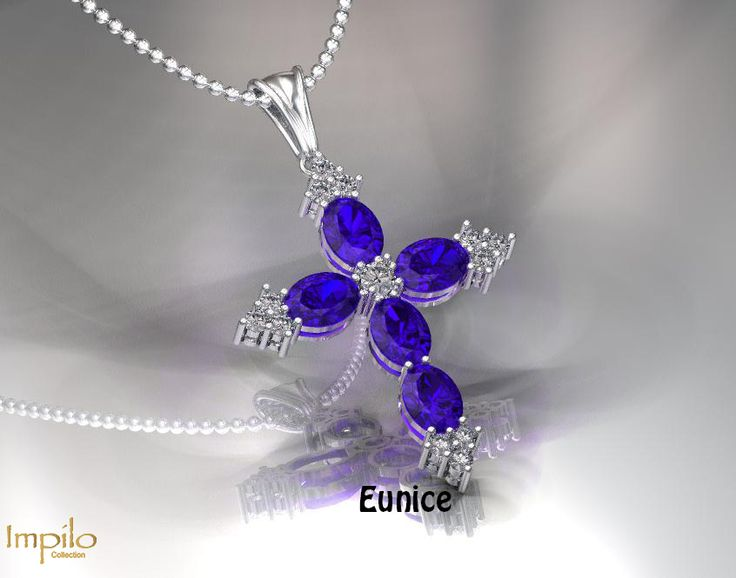 """""""Eunice"""" - Stunning oval cut, blue sapphires makes up this beautiful cross with round brilliant cut diamonds adding that sparkle."""