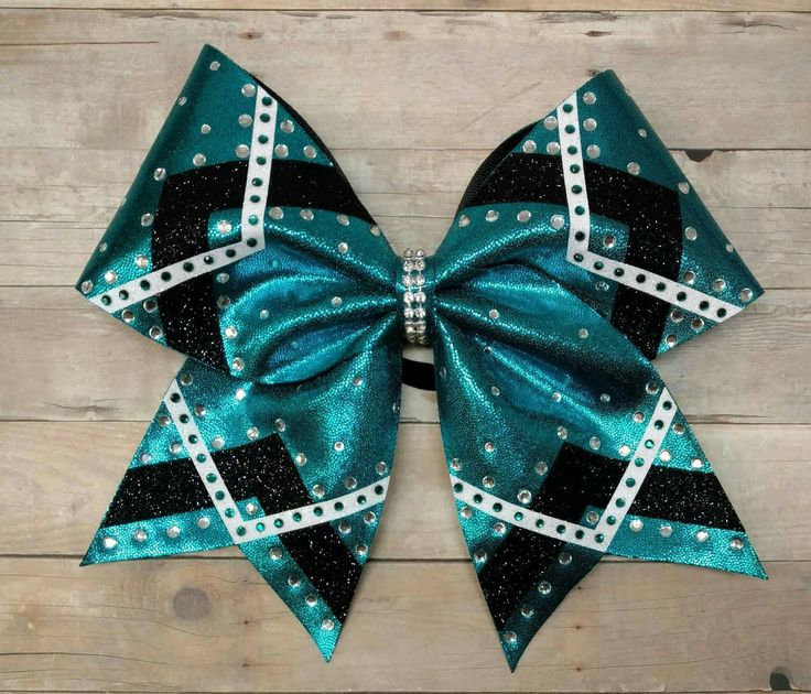 Teal and black cheer bow, custom cheer bow, rhinestone cheer bow, team cheer bows, big cheer bow, glitter cheer bow, competition cheer bow by ThatSparkleShop on Etsy https://www.etsy.com/listing/508937865/teal-and-black-cheer-bow-custom-cheer
