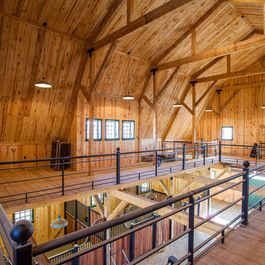 Gambrel Horse Barn in Nebraska.. This is so crazy but gorgeous and great storage. :O definitely a dream barn! Hope I can afford something HALF this nice in the future.