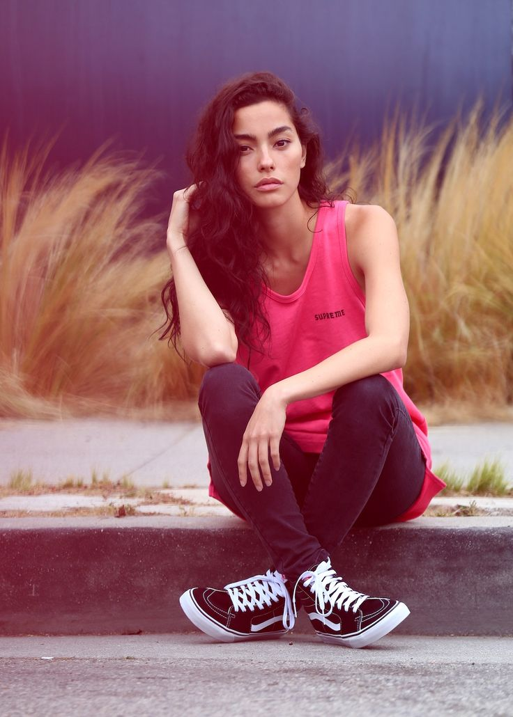 Adrianna Ho of Sweat The Style kicking back in a classic tank and Sk8-Hi's