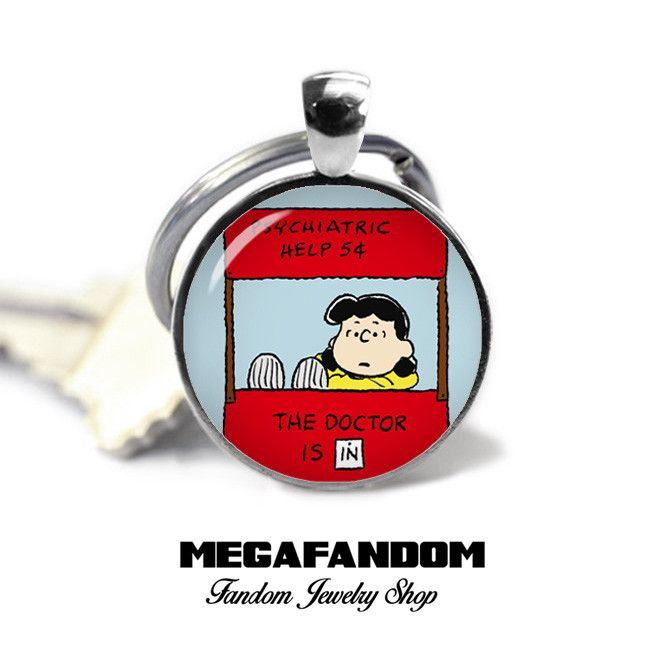 "Lucy Van Pelt Psychiatric Help Keychain. 1"" circle Keyring with a beautiful high resolution printed image sealed under a high quality glass dome. Silver plated pendant tray. Comes with a silver plated                                                                                                                                                                                 More"