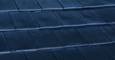 Boral Terracotta Shingle Metallics Roof Tiles - New to market and now available, the 'Meteor' dark grey and 'Galaxy' black have been designed for those seeking lustrous and metallic finishes.  A contemporary flat profile in a premium metallic finish will make a striking and long lasting statement on any home.