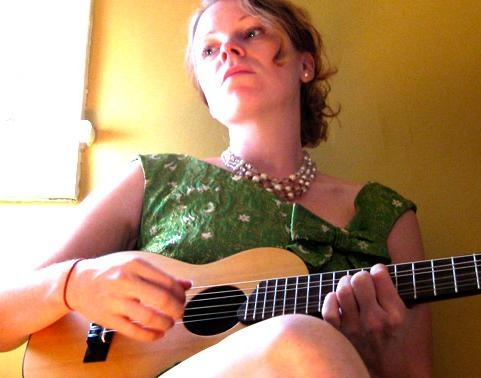 That she plays a guitalele from time to time is only ONE reason to love Janine Stoll. Others include her cool, precise alto voice, her crystalline guitar playing, and the slightly twisted perspective she brings to songs. Nobody else is like her.