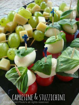 little caprese and small snacks of cheese and grapes - Capresine e stuzzichini