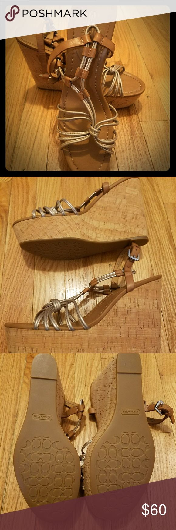 Metallic Georgians Coach Wedges Metallic strappy sandal-style wedge heels. Tan cork wedge heel, tan leather sole, and silvery/gold straps. Only worn twice. Very comfortable and stylish. I'm tall and the heel was a bit too high for my style. Coach Shoes Heels