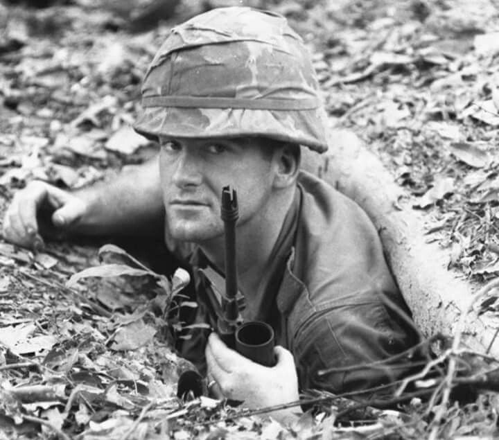 """This image originally appeared in Stars & Stripes Magazine in 1967. Photo tag with name:"""".... South Vietnam, February, 1967: Sgt. Dan R. Paul of Fayetteville, N.C., with Charlie Co., 1st Battalion, 26th Infantry, 1st Infantry Div., stands in the entrance of a tunnel during the search of what was described as part of the Viet Cong supreme headquarters in the jungle north of Tay Ninh during Operation Junction City..... By Joe Gromelski Stars and Stripes...."""" Via ~ The NAM (tag cred ~ Bob B.)"""