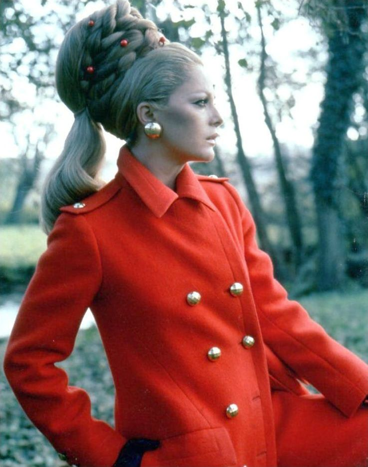 Virna Lisi wearing a Valentino coat (of red wool, of his couture collection for the Autumn/Winter 1967/68) and photographed at a park in Rome for Vogue Italia, 1967.