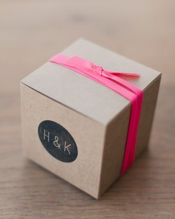 Kraft boxes bundled with hot pink ribbon and rubber stamped with a custom design