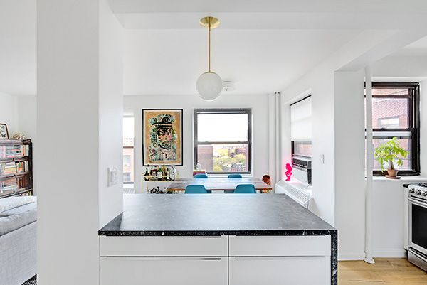 """""""For the countertops, we went with honed black granite because we wanted the look of a soapstone or black marble, but with a little more durability. The stone looks fantastic and is really a great contrast to the high-gloss cabinets."""""""