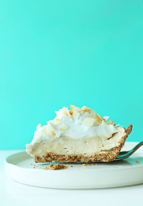 10-ingredient vegan coconut cream pie with naturally sweetened oat-almond crust and coconut pudding filling, topped with fluffy coconut whipped cream!