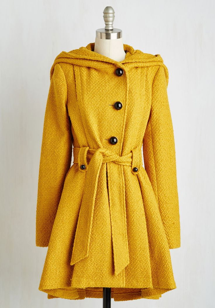 Once Upon a Thyme Coat in Mustard. This coat by Steve Madden showcases a classic mustard hue, elegant pleats, and a cape-inspired neckline wrap that's a fairytale-come-true! #yellow #modcloth