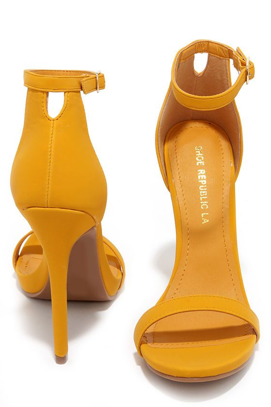 """Enjoy the perfect pop of color with the Boldest Trick in the Book Yellow Nubuck Ankle Strap Heels! Smooth vegan nubuck in mustard yellow shapes a skinny toe strap, plus an adjustable ankle strap (with gold buckle) on a high-rise heel cup. 4.75"""" wrapped stiletto heel. Cushioned insole. Nonskid rubber sole. Available in whole and half sizes. Measurements are for a size 6. All vegan friendly, man made materials."""