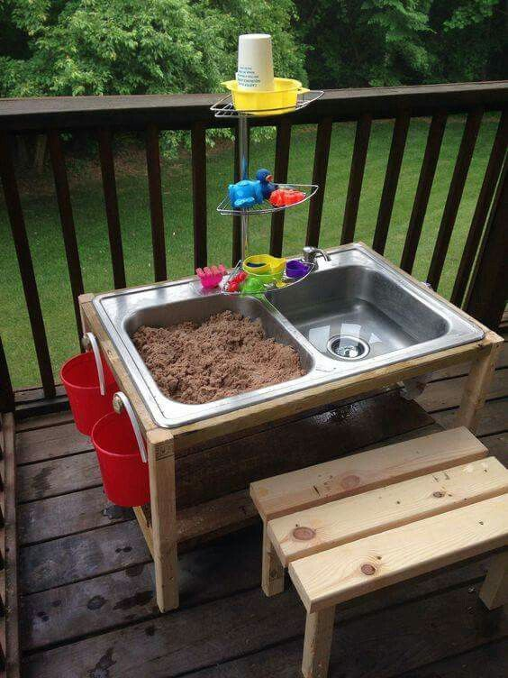 Reperpose kitchen sink! Turned into kids play station! Super cool idea!