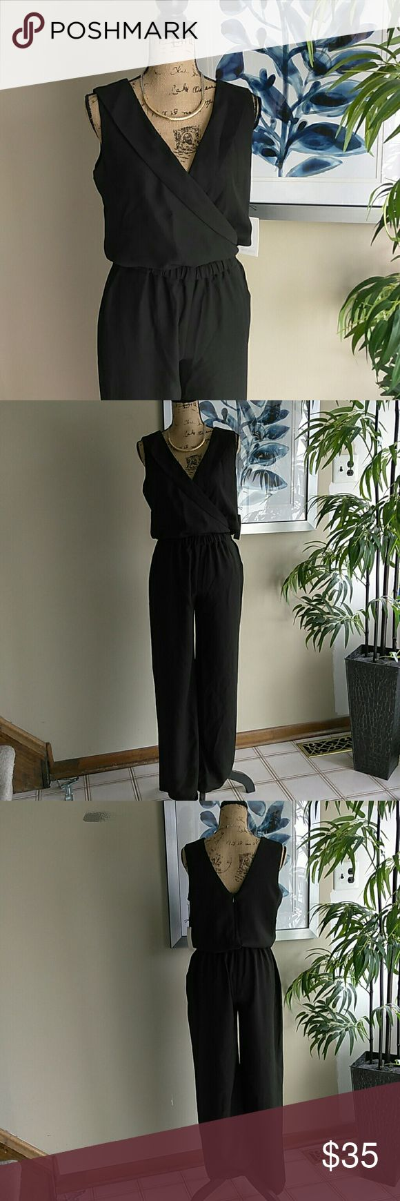 'Sabrina' Sexy Black JumpSuit Size Large P NWT Sexy & sophisticated. NWT Oliver Grace 'Sabrina' Simple Black Jumpsuit / Romper. Size Petite Large. Bought at Nordstrom. Pants with attached top. Small hidden zipper at back. Elastic waist. Black V-neck jump suit. Sleeveless romper. BRAND NEW WITH TAGS, NEVER WORN! In fabulous condition! Tried on one time. Feel free to ask questions. MAKE ME AN OFFER! FREE GIFT with every purchase! Bundle for further discounts. Oliver Grace Pants Jumpsuits…