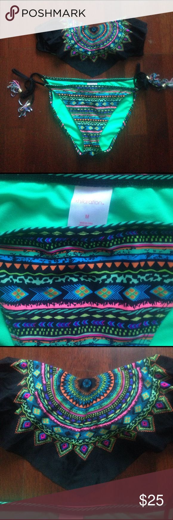 Aztec Bikini top & bottom. Barely worn. This cute two piece is adorable. All sorts of pretty colors combined to give it a unique look. Xhilaration Swim Bikinis
