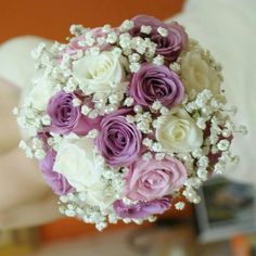 Perfectly Pretty Wedding Bouquet Comprised Of: Violet Roses, Lavender Roses, White Roses, White Gypsophila, & Pearl Pins