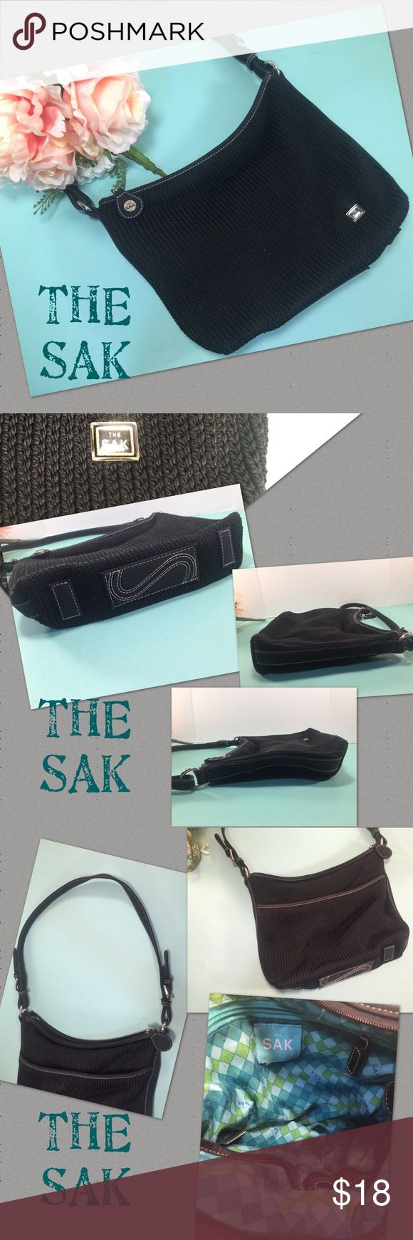 THE SAK Black Woven Bag THE SAK Black Woven Bag has silver tone hardware, contrast stitching, large exterior slip pocket, overall top zip closure, signature base, and adorable blue and green harlequin interior lining. One interior zip pocket, two slip pockets, & a few additional storage spots. Exterior looks nice, and interior shows moderate to heavy wear due to prior usage. Nothing major, but definitely signs of use! Super adorable bag & can be used anytime of year. Orig. $58.50 The Sak…