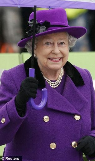 Purple rain: Queen Elizabeth brightens up a damp day in a stylish violet coat…