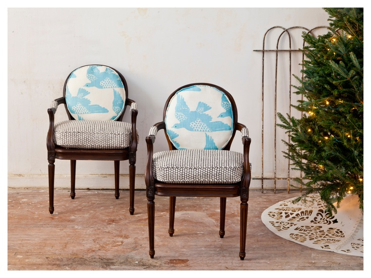 A vintage pair of caned chairs re-done in gorgeous fabric from Hable Construction.