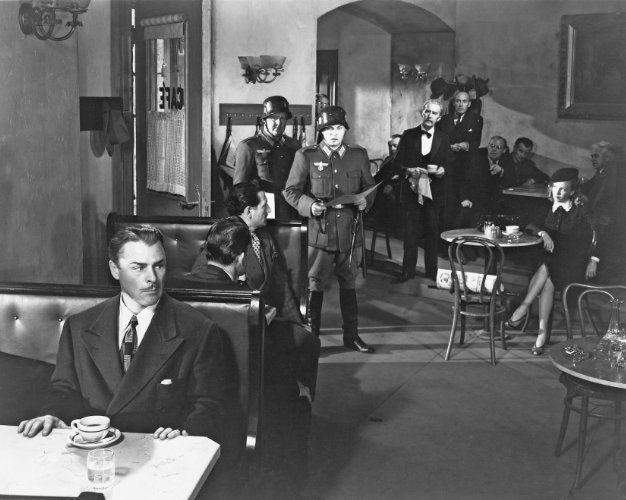 Walter Brennan, Brian Donlevy, and Anna Lee in Hangmen Also Die! (1943)