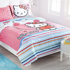 "Create a space that kids love spending time in and make their bedroom a fun, bright and colourful space that will foster great imaginations and bring out creativity. Our HELLO KITTY Collection is a perfect choice for fans of this little feline friend. Featuring bright colours and fun prints in soft microfibre this comforter is sure to make bedtime something to look forward to.  Polyester-cotton microfibre with polyester fill Reverses to a coordinating print 72"" w. x 87"" l. Machine wash"