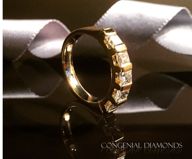 5 stone eternity ring in  yellow gold