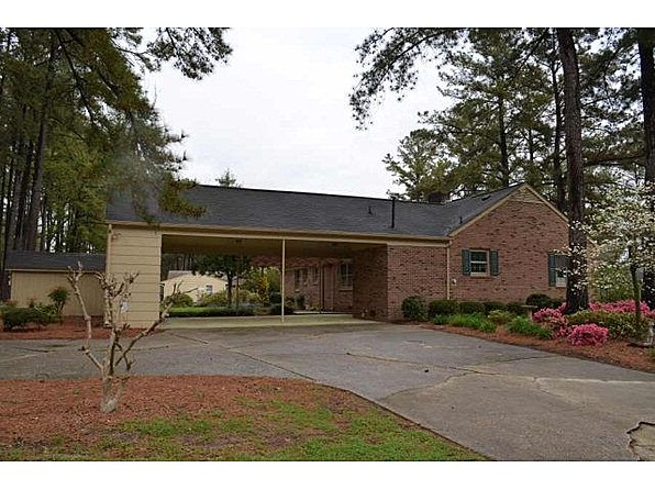 Brick ranch with 2 car attached carport w storage room for Brick carport