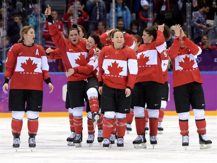 Canada celebrates after Marie-Philip Poulin (#29) scored the game-winning goal against the United States in overtime, during the Ice Hockey Women's Gold Medal Game on Day 14 of the Sochi 2014 Winter Olympics at Bolshoy Ice Dome.