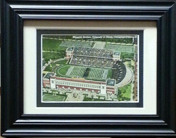 This is a very attractive hand-colored postcard showcasing the original Memorial Stadium, home of Illinois Fighting Illini football. Vintage is 1930-49. It is postally unused and in excellent condition. Comes in a 6 3/4 x 8 1/2 black easel-back frame with 2-color mat and attached triangle hanger for wall mounting. #giftsforhim #vintage #dormdecor #postcards #illinois #fightingillini