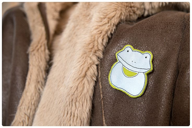 A frog. A little bit shy. Hand made soft reflector brooch.   https://www.facebook.com/helkivad