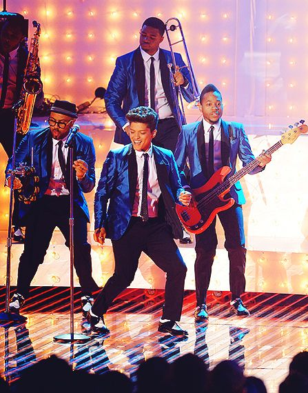 Bruno Mars, I love the little routines he does with his band!!