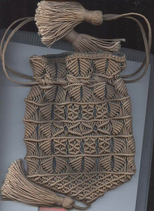 Sailor's macrame antique purse. Love the oversized tassel's and 'V'-shaped bottom.