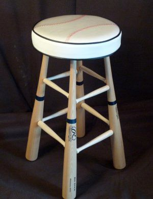 """Wooden bats cost nothing at Wal Mart, Dick's, anywhere!  Go by 4 (or 8) and attach them to a seat... It's an awesome way to personalize a """"man cave"""" or maybe even a nursery"""