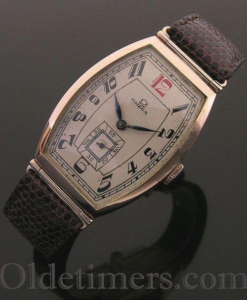 1930s 14ct gold tonneau vintage Omega watch