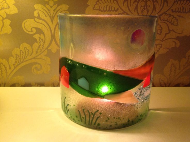 Fused glass with tea light behind.