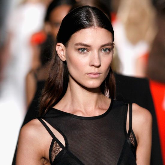 Taken at Victoria Beckham's Spring 2013 show. Sleek natural looking hair with a touch of wet top and a flowing bottom. #VictoriaBeckham #Sleek #Hair #ParelleCosmetics #Beauty #Wetlook