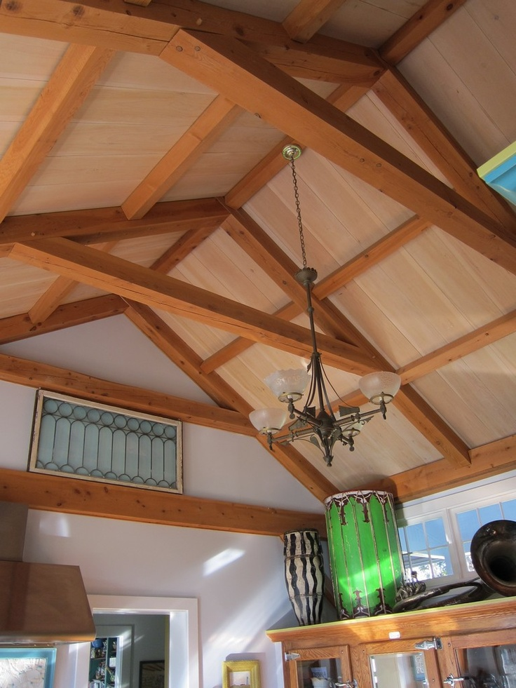 Vaulted ceiling with post and beam timber frame White