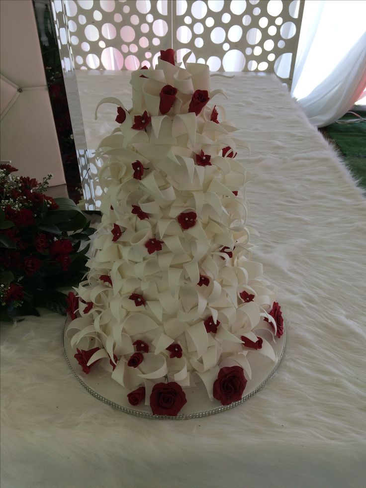 Clusters of spiky petals with red roses