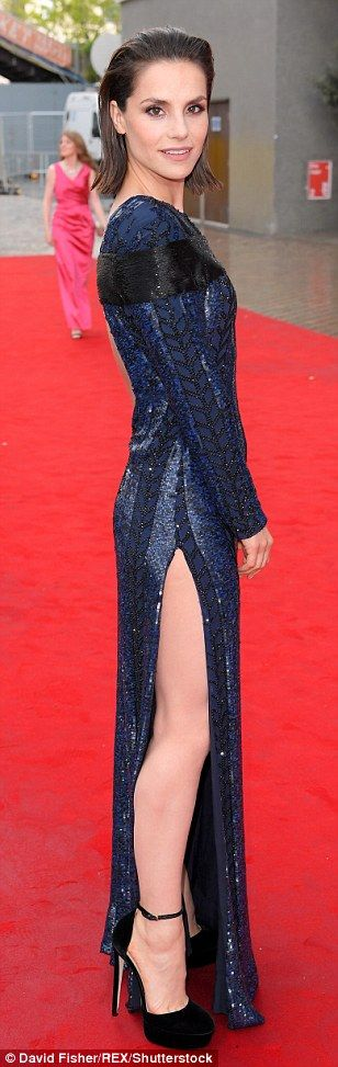 Thigh's the limit: Actress of the moment Charlotte Riley opted for a glittering navy gown ...