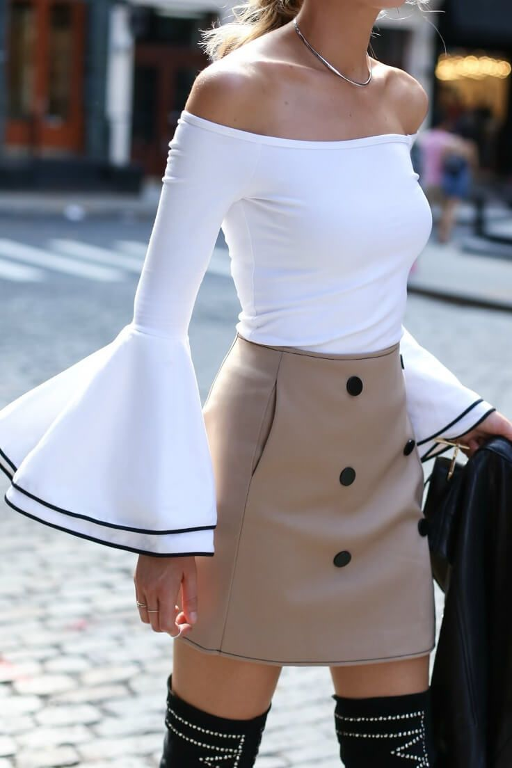 2c8169e4858b5 Elegant blonde is wearing an off-the-shoulder bell sleeve top and a  high-waisted beige skirt. Create a classic silhouette with a slim-fitting bell  sleeve ...