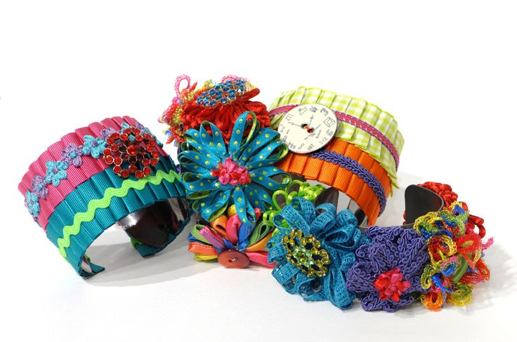Handmade silk flowers and vintage buttons bracelets designed by Daphne Valente